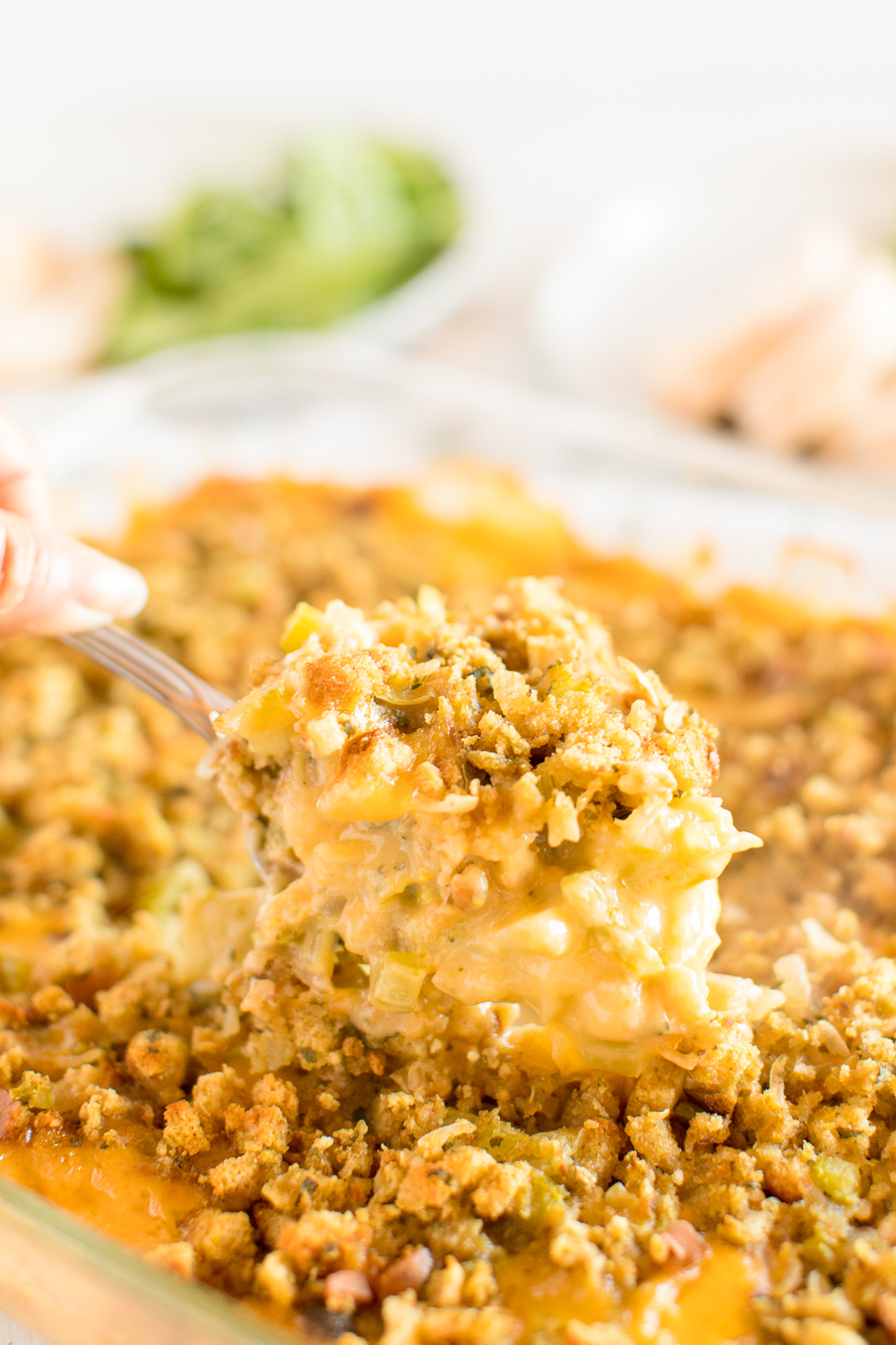 Broccoli Cheese Casserole is a wholesome, comforting side dish that'll compliment any meal. Made with broccoli florets, creamy soups, cheddar cheese, and herb stuffing, try making and sharing it at your next get-together!