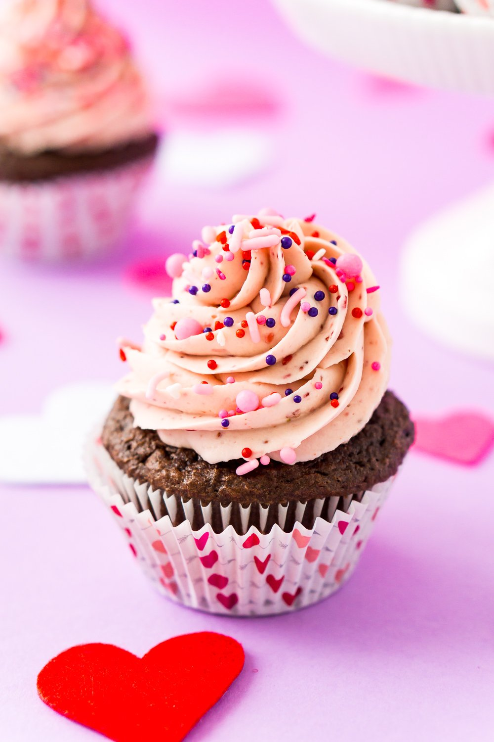 These Strawberry Chocolate Cupcakes are a delicious blend of rich chocolate cake and sweet strawberry whipped cream frosting! Perfect for Valentine's Day, Baby Showers, Bridal Showers, and more!