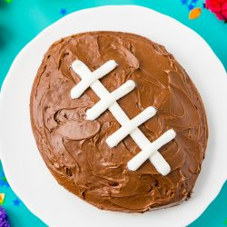 This Easy Football Cake is the perfect game day dessert! Use this simple step-by-step tutorial to make this recipe for your next football party!