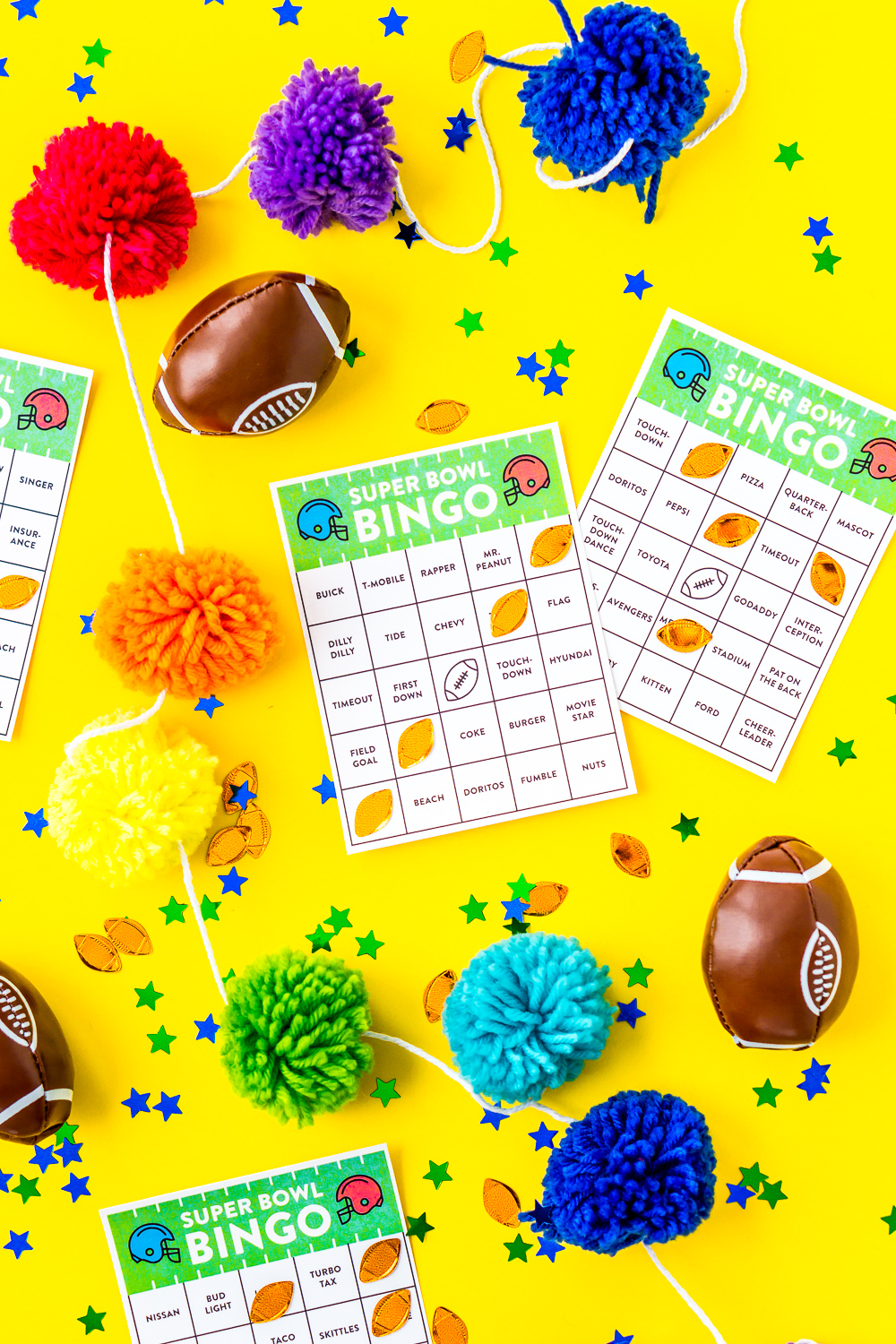 Super Bowl Bingo Cards on yellow background with pom poms, mini footballs, and confetti.