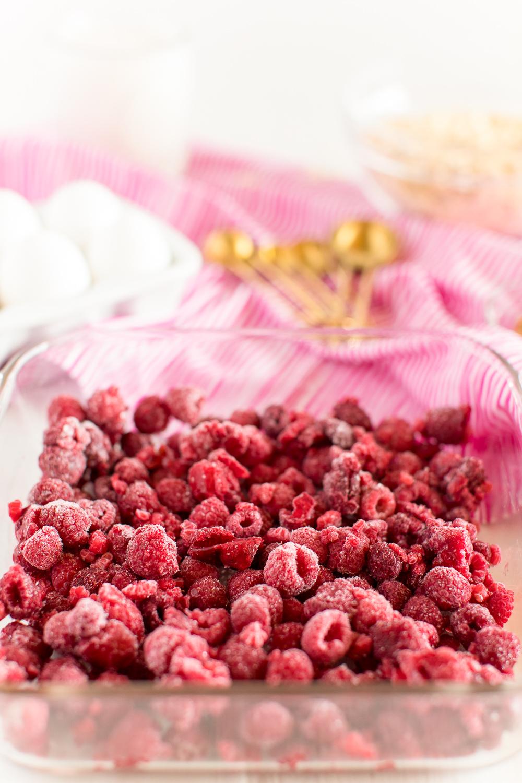 Frozen raspberries in baking dish.