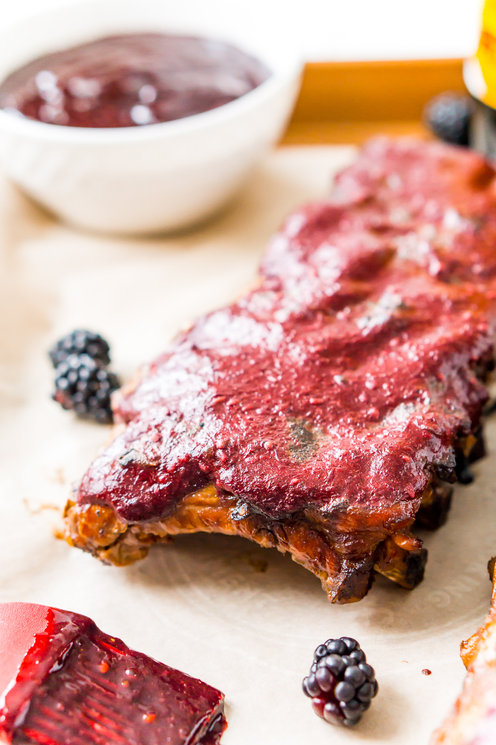 Baby back ribs on sheet pan with blackberry barbecue sauce