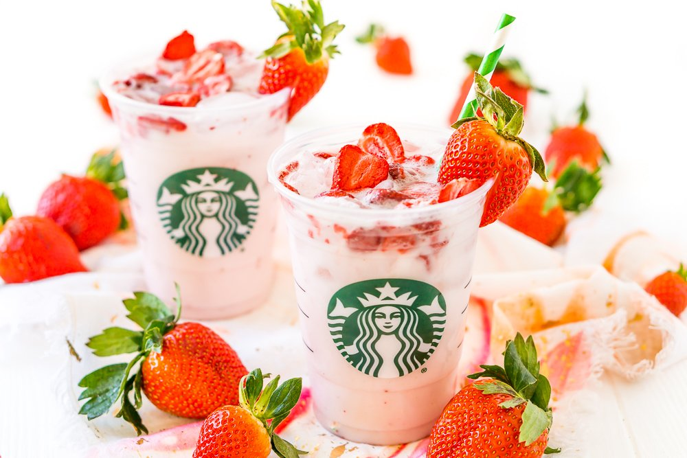 This Copycat Starbucks Pink Drink is a cheaper and just as delicious recipe to make your favorite fruity Starbucks beverage right at home with acai berry tea, coconut milk, white grape juice, simple syrup, and freeze-dried strawberries!