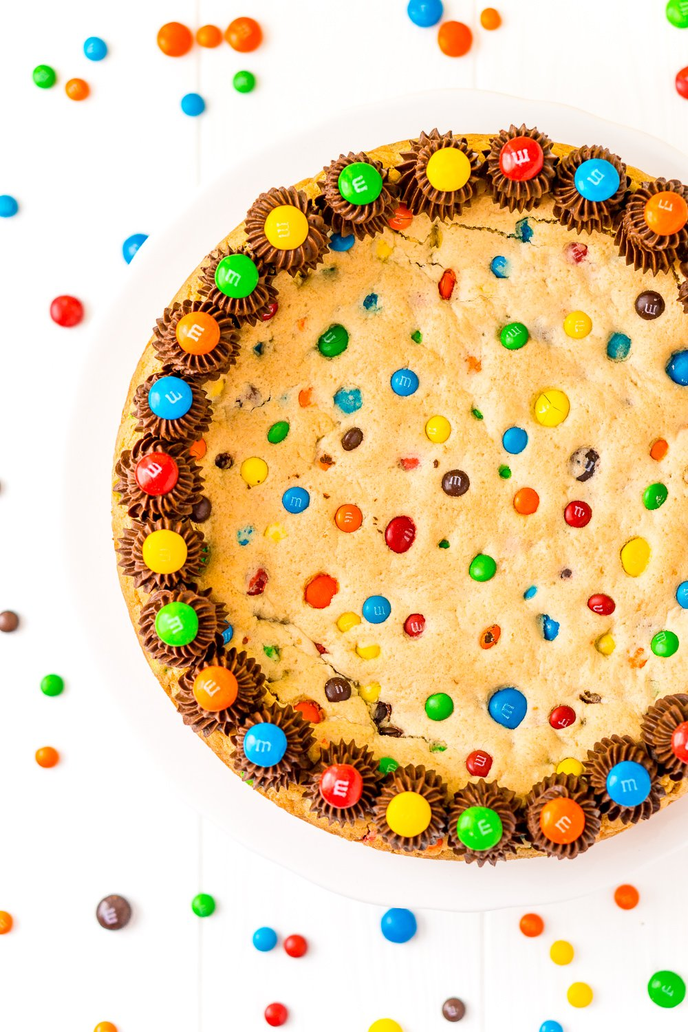 Overhead of M&M's Cookie Cake on white background.