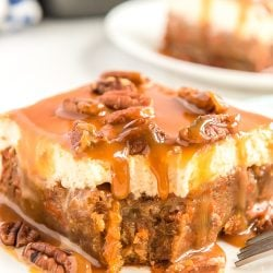 This Sea Salt Caramel Carrot Cake Poke Cake is so sweet and delicious, you'll never want any other carrot cake again! Baked to perfection and saturated in sweetened condensed milk, then topped with fluffy frosting and drenched in caramel sauce.