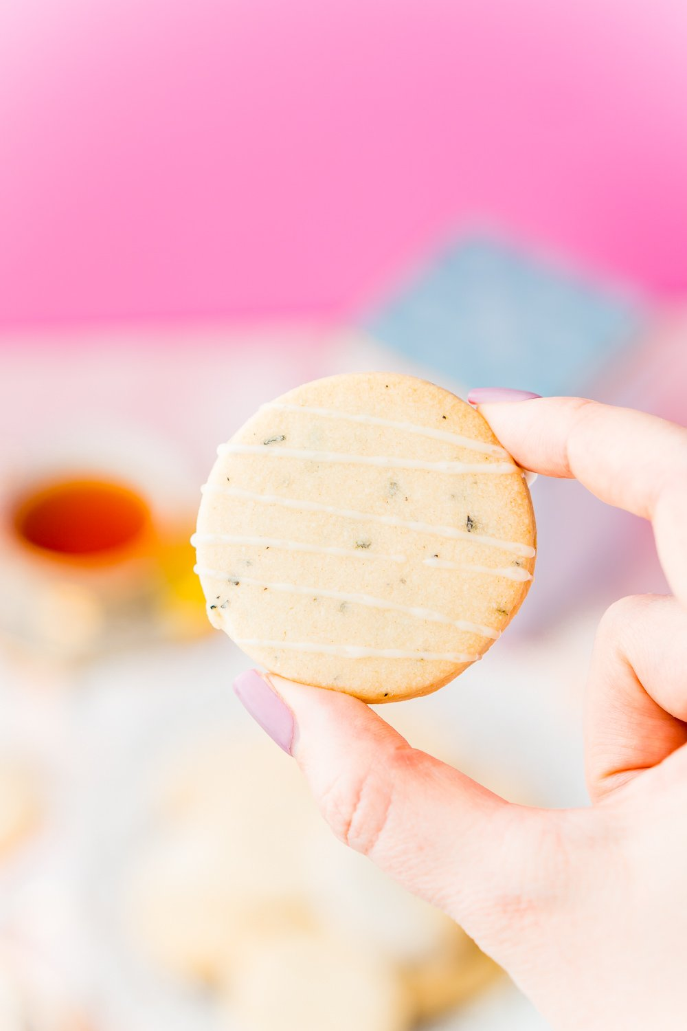 Woman's hand holding an Earl Grey Shortbread Cookie.