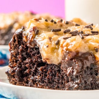 This German Chocolate Poke Cake takes the classic dessert recipe to a whole new level with a tender chocolate cake soaked in sweetened condensed milk and topped with a rich chocolate ganache and sweet coconut pecan frosting!