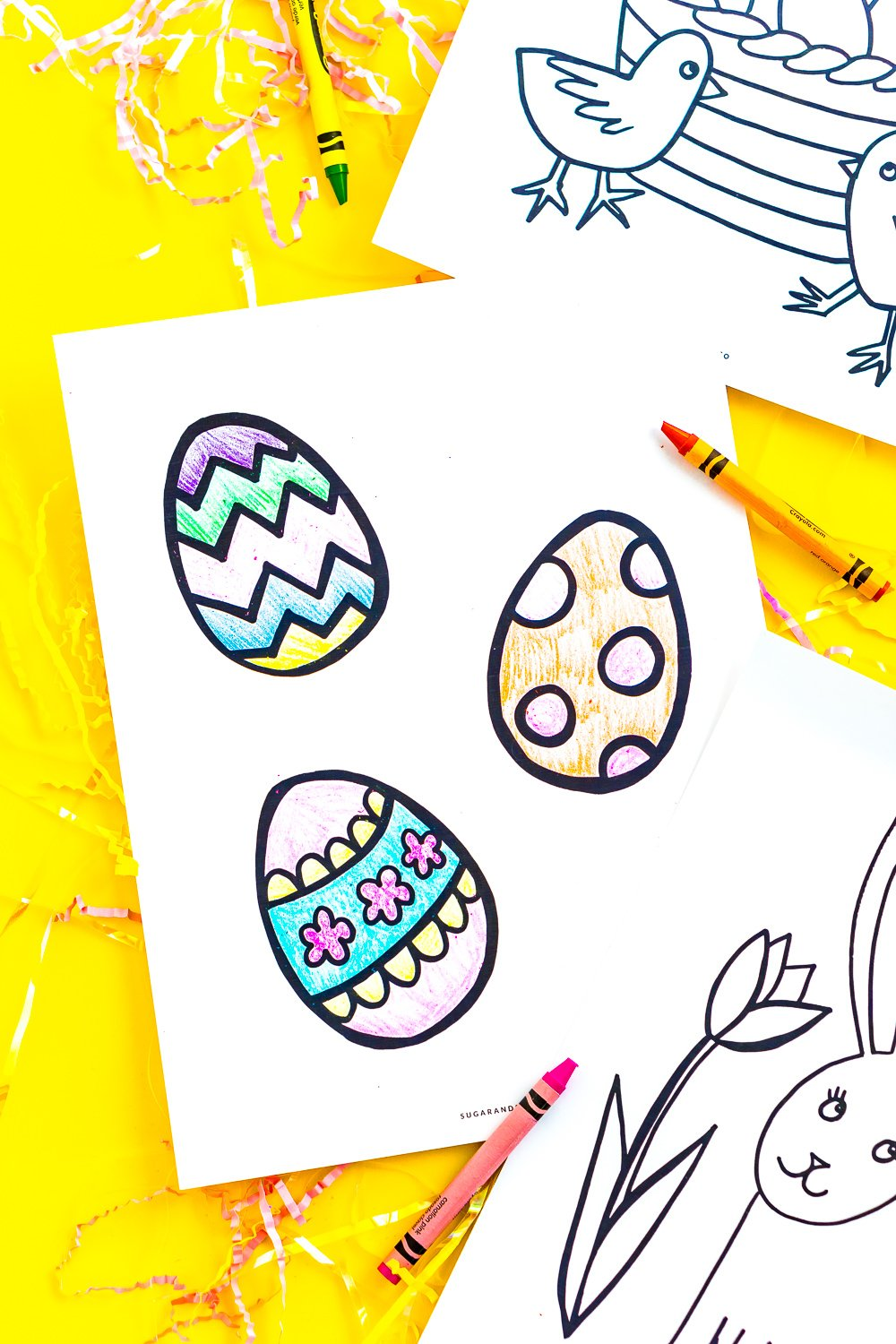 Easter egg coloring page that's been coloring in with pink, purple, blue, green, and orange.
