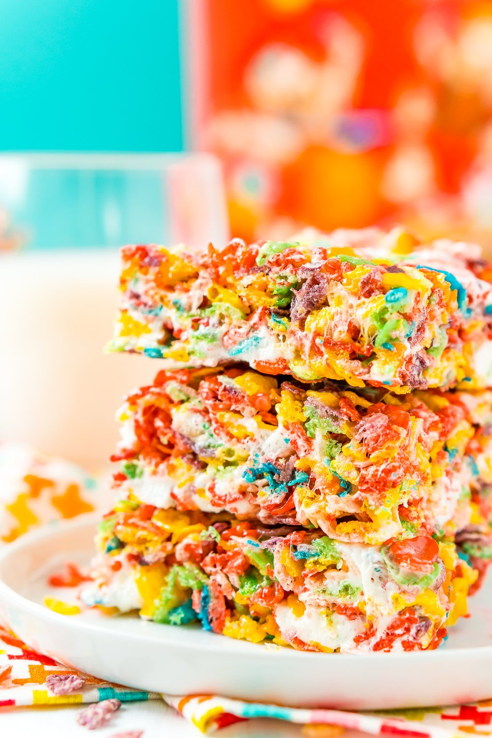 These Fruity Pebbles Treats are a fun and fruity twist on the classic no-bake dessert made with Rice Krispies cereal. They are made with the perfect blend of cereal, butter, and marshmallows and take just 7 minutes to prepare!