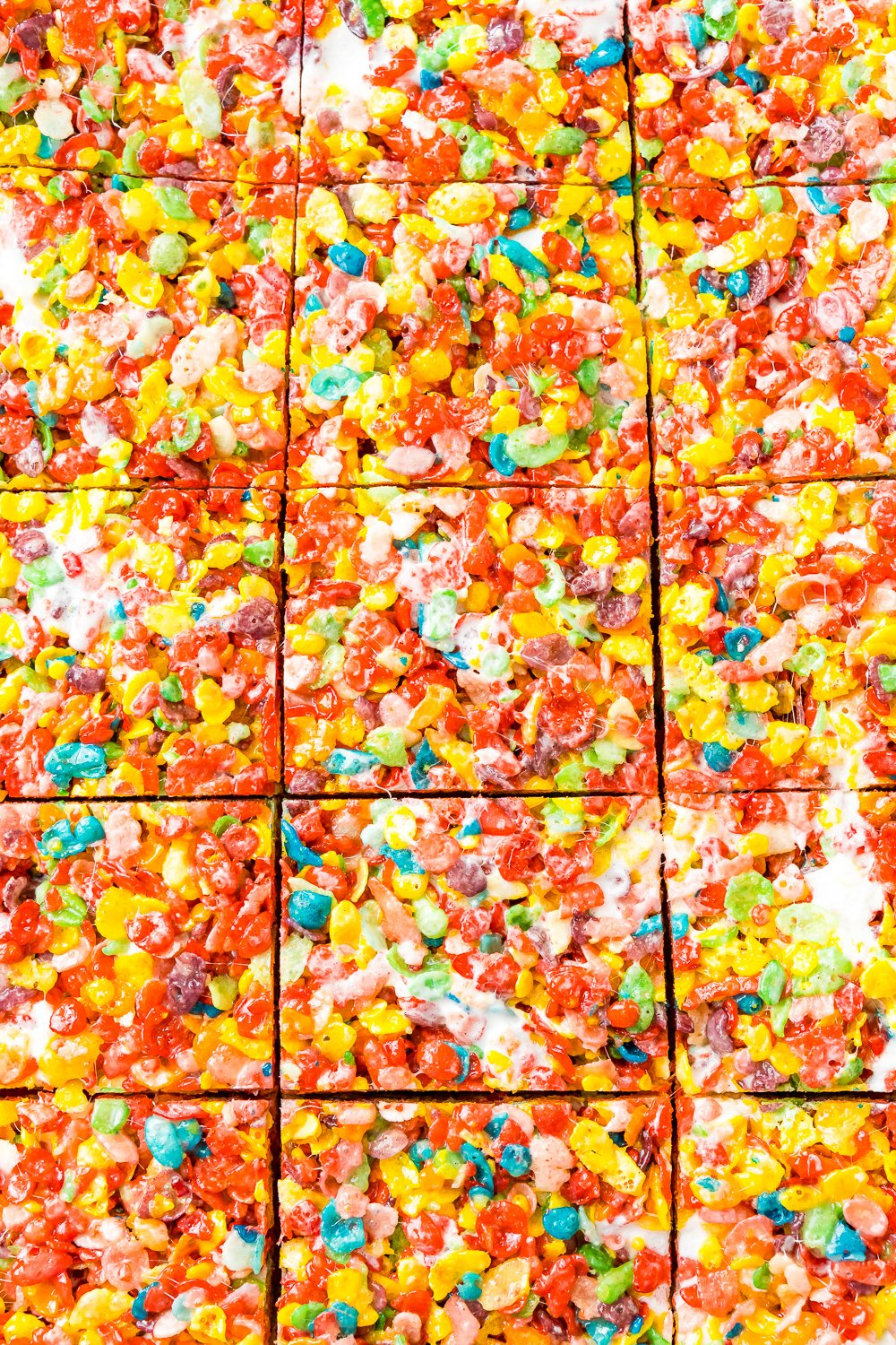 Close up of Fruity Pebbles Treats that have been sliced but not yet pulled apart.