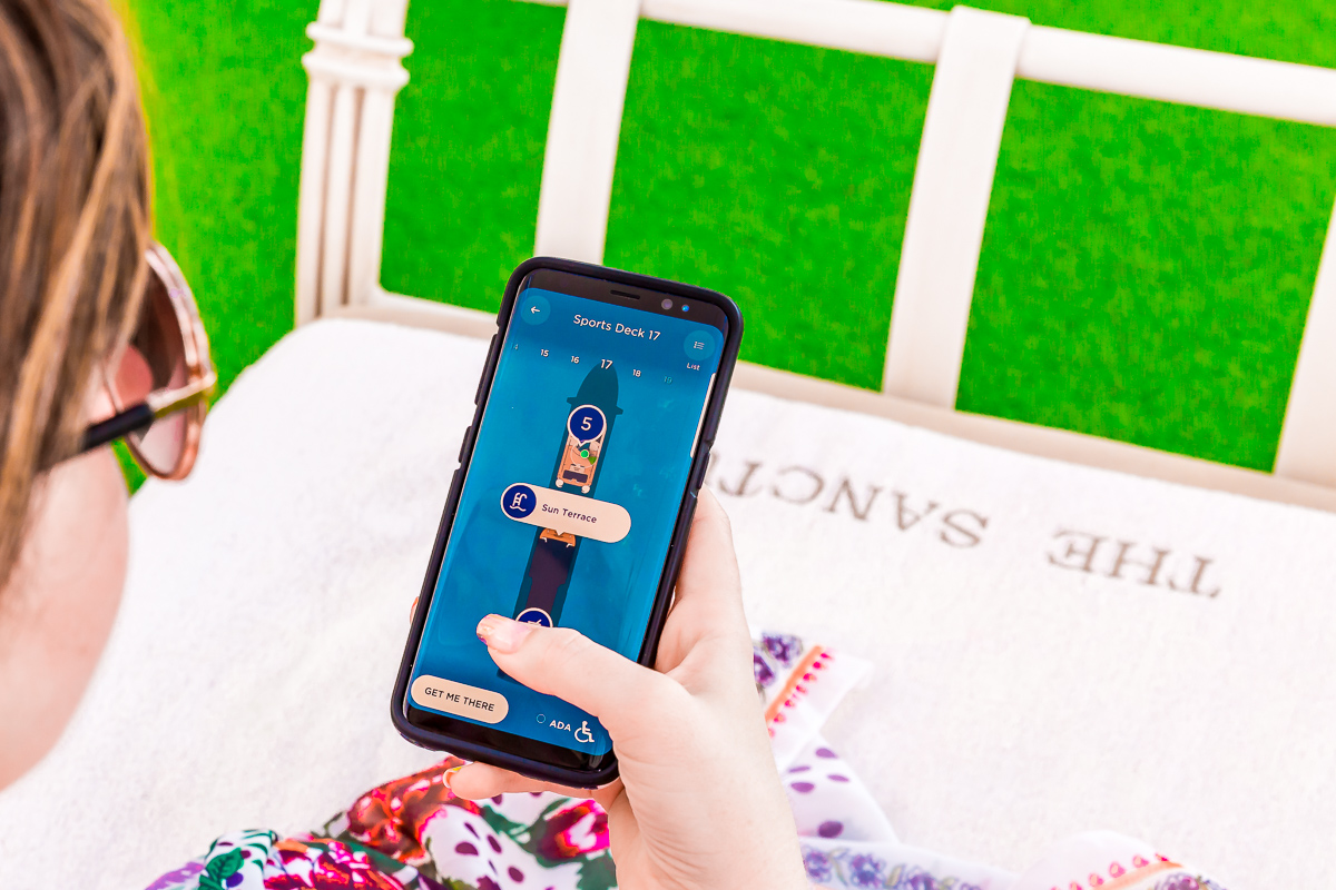 Woman using an Ocean Medallion app on her phone on a Princess Cruise.