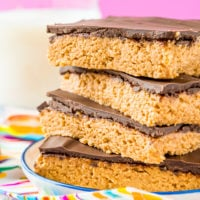Peanut Butter Bars are a classic, 5-ingredient dessert recipe that can be made in less than 10 minutes! Made with a blend of peanut butter, graham crackers, powdered sugar, butter, and chocolate!