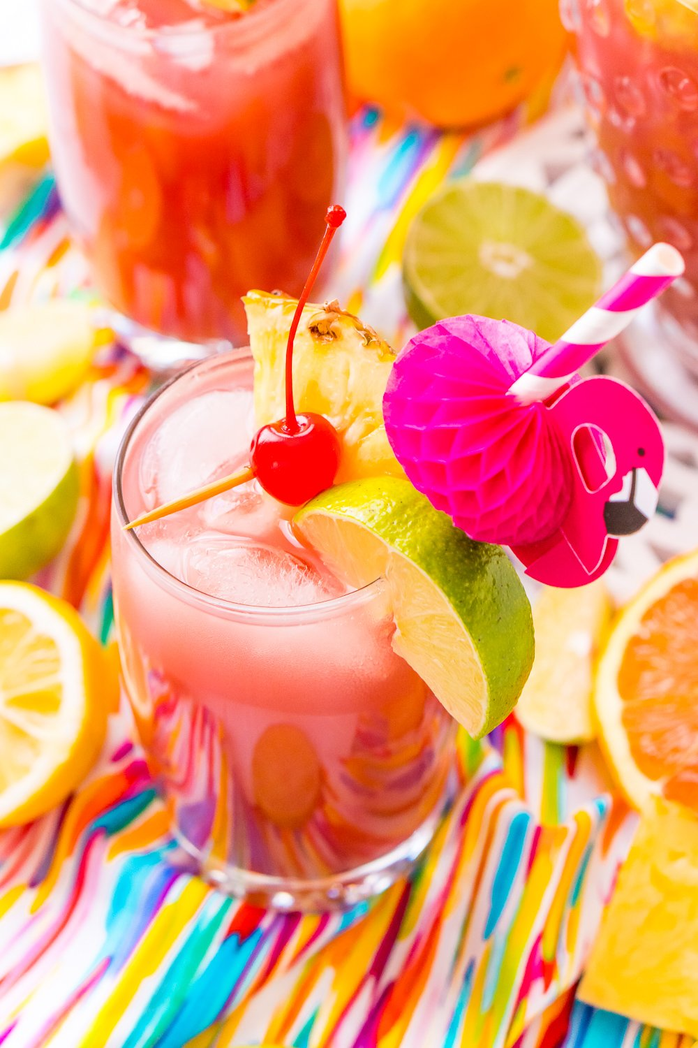 Rum Punch combines orange, pineapple, cranberry, lime, and lemon juice with ginger ale and three different kinds of rum for a delicious large batch Caribbean inspired cocktail for summer parties!