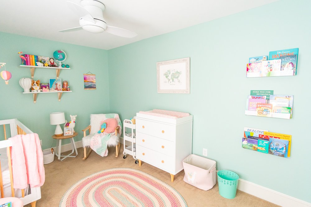 This Travel Themed Nursery is filled with simple and stylish inspiration for a baby girl's room! With custom pieces, modern furniture, and global decor!