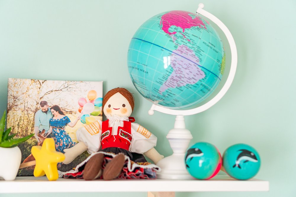 Travel inspired decor on shelf for nursery