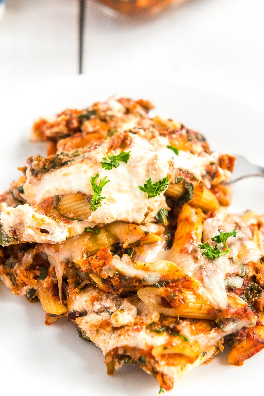 Turkey Florentine pasta bake served on a white plate.