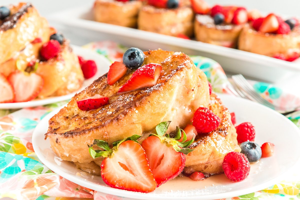 Berry Stuffed French Toast is a fruity, creamy, and indulgent breakfast recipe that combines macerated berries with a sweet mascarpone mixture and thick slices of French bread.