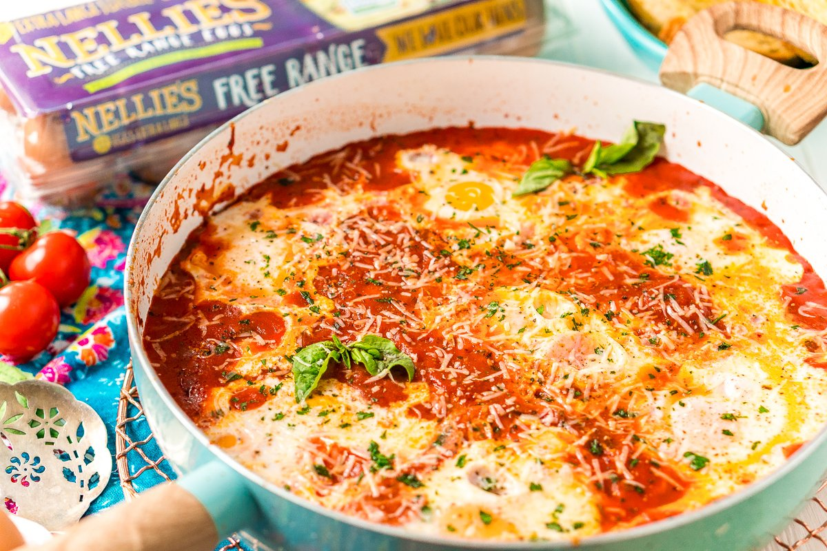 Eggs In purgatory in a blue skillet.