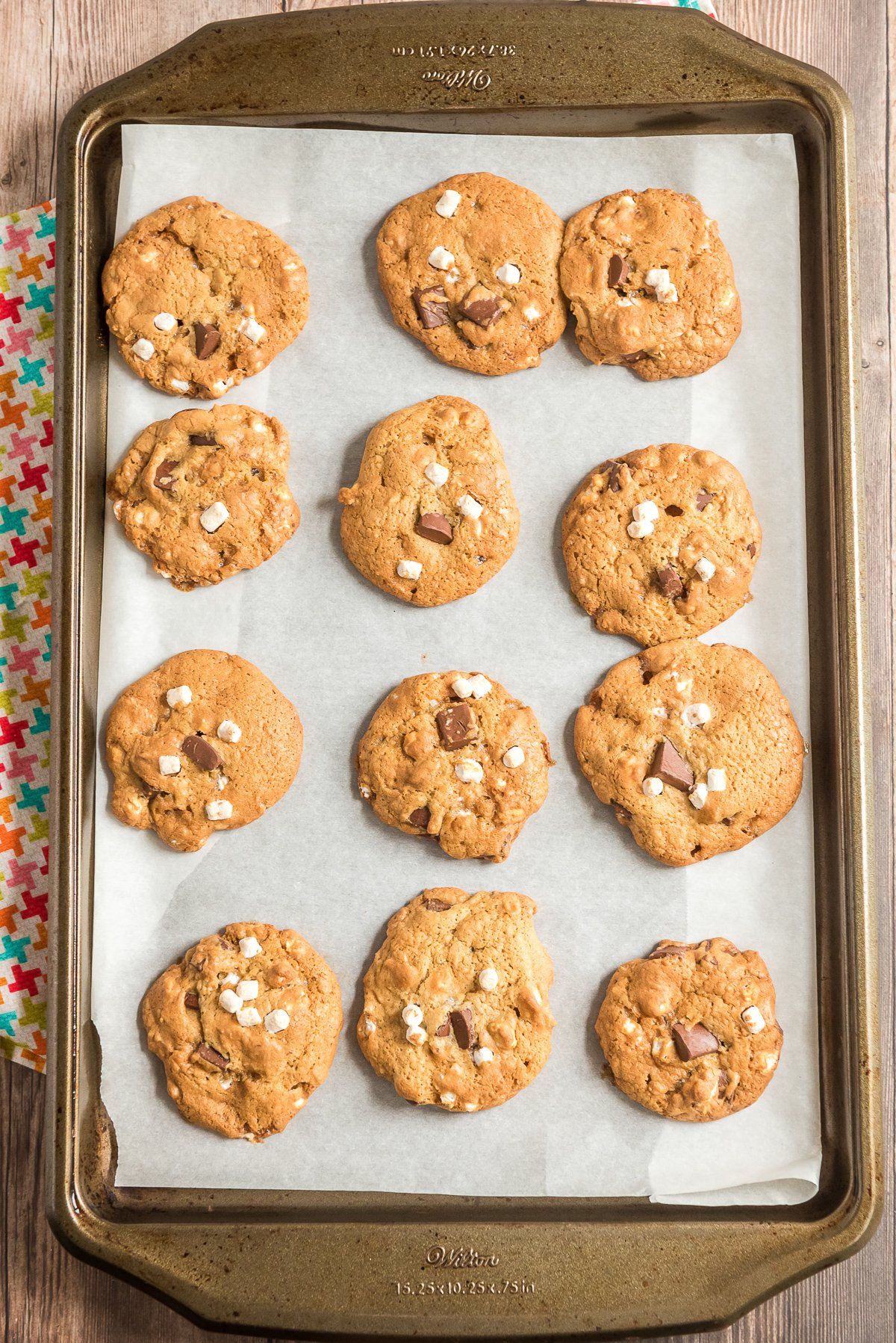 Baked cookies on a parchment lined baking sheet.