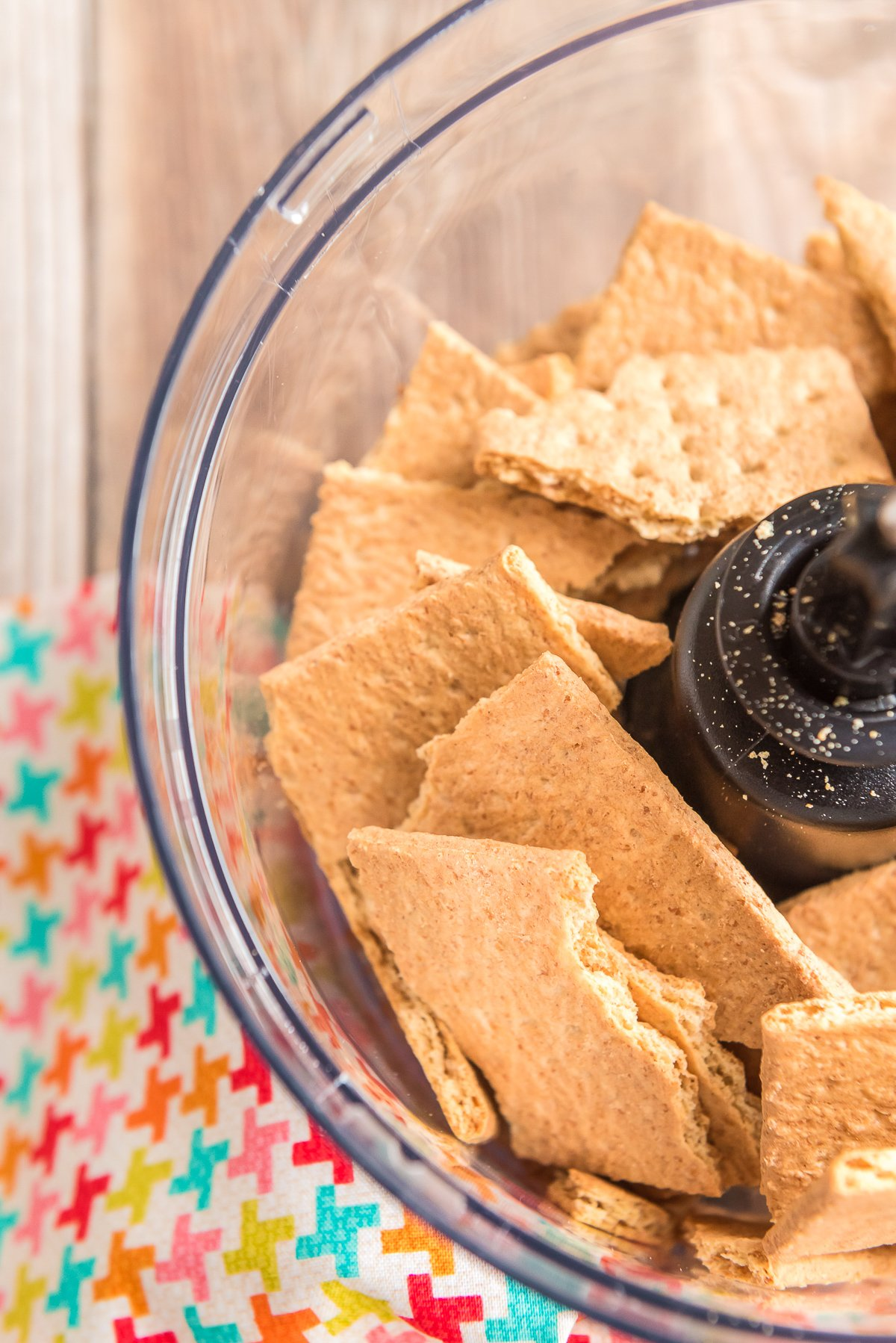 Graham crackers in a food processor getting ready to be blended.
