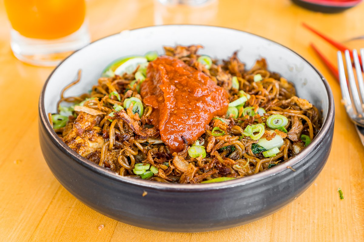 pork & crab mee goreng in a black bowl at The Honey Paw, an Asian fusion restaurant in Portland, ME