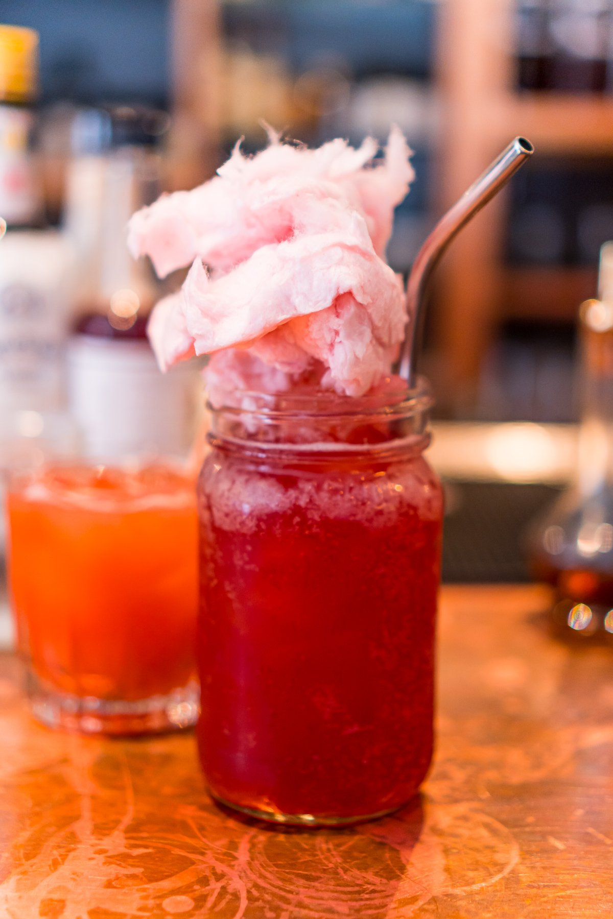 Cocktail served in a mason jar with cotton candy on top in Portland, Maine restaurant.