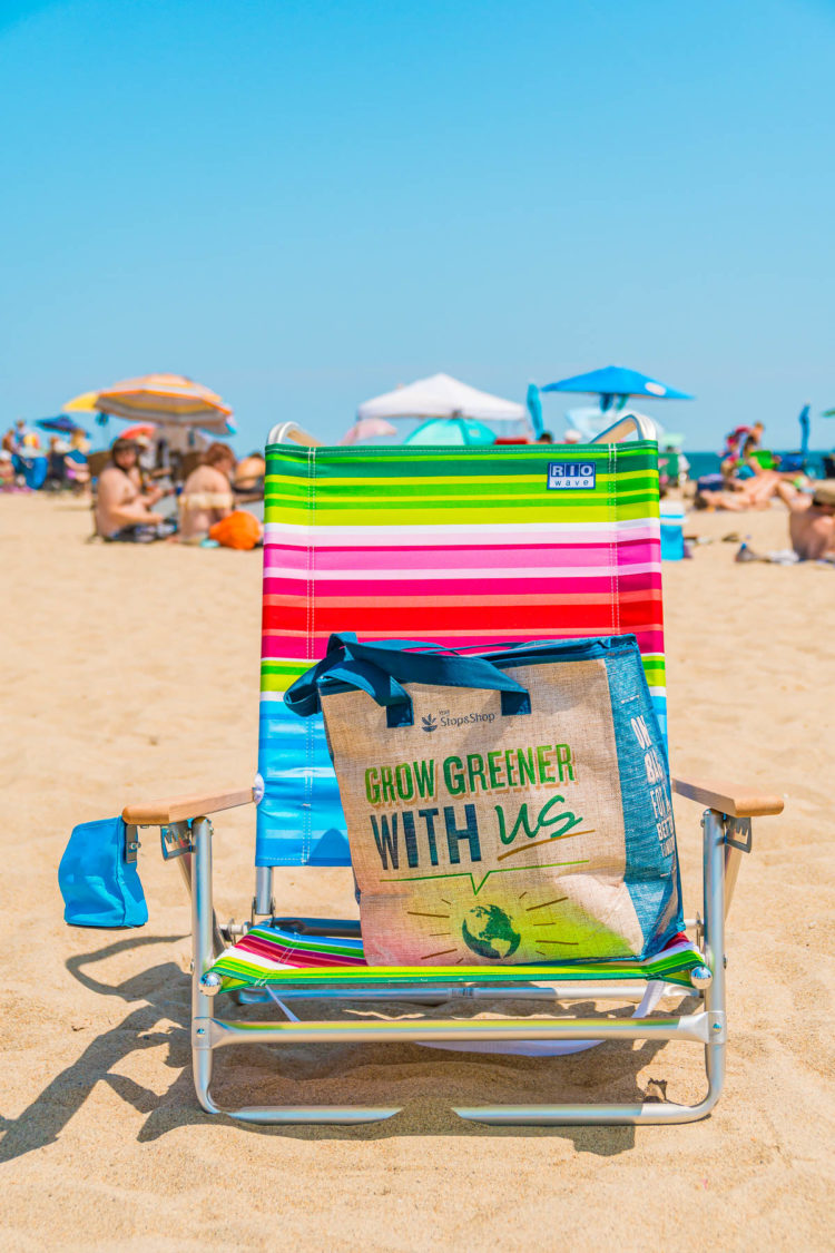 Colorful beach chair with a reusable Stop & Shop grocery bag on it.