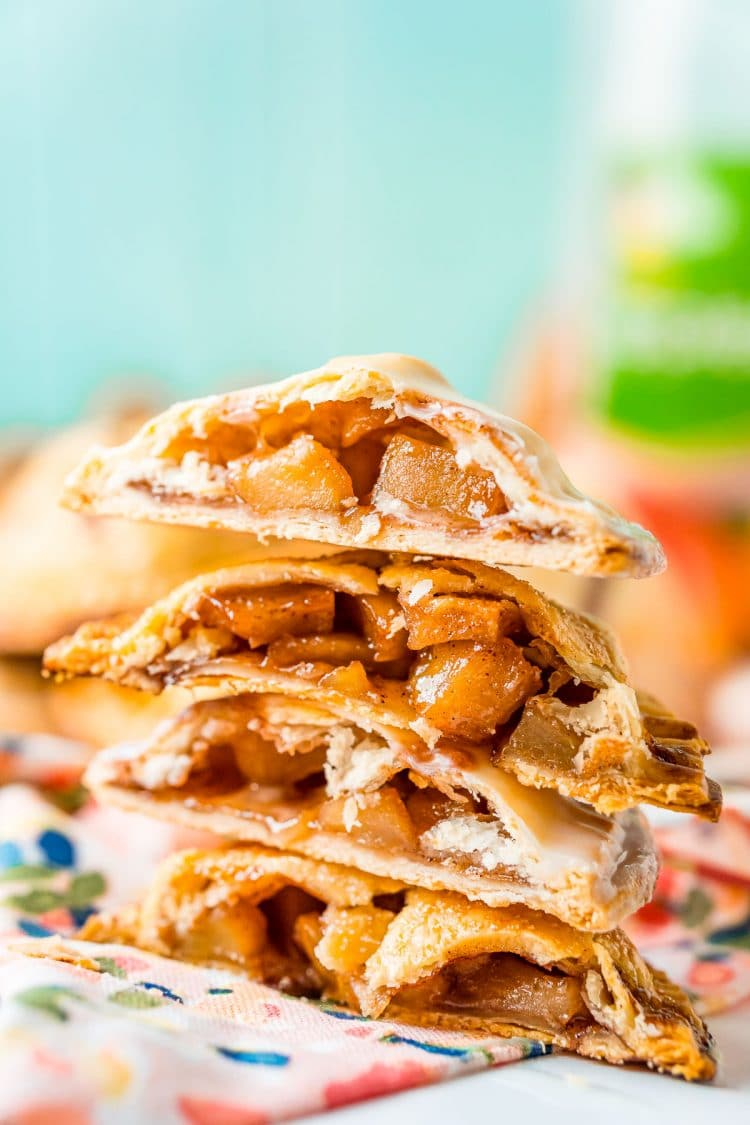 A stack of apple hand pies that have been cut in half.