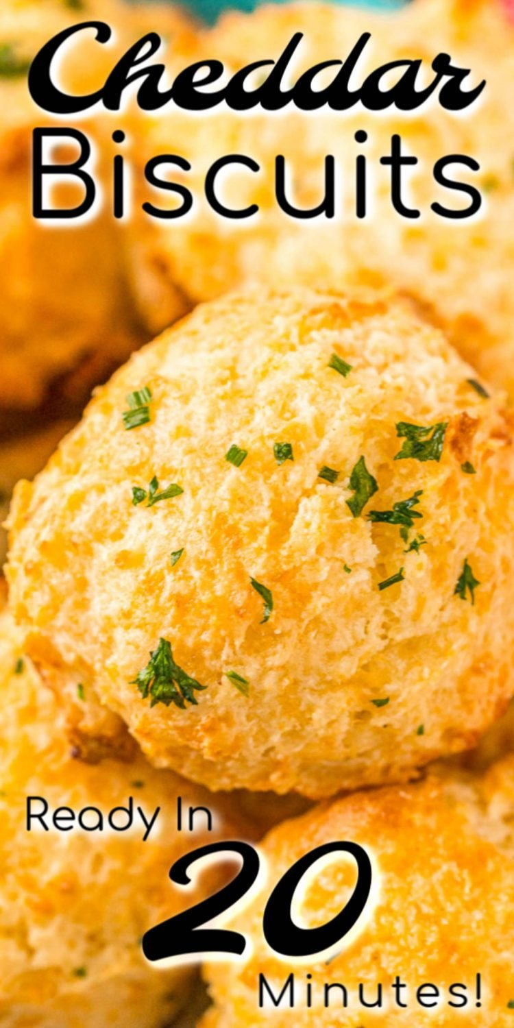 Close up image of cheddar biscuits with text over the image for pinning.