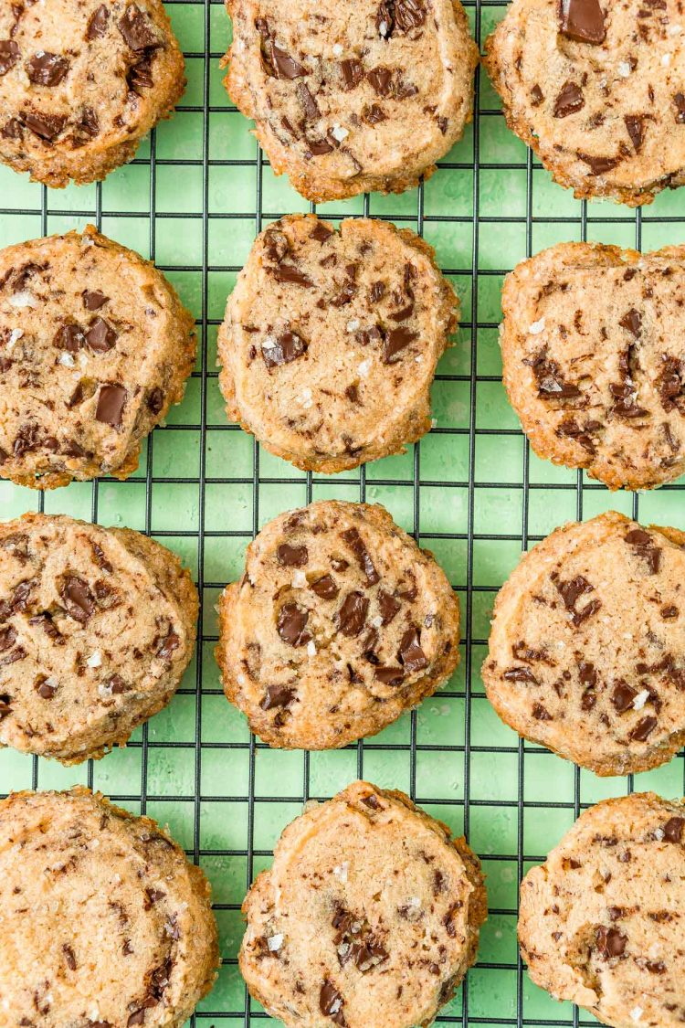 Salted Chocolate Chunk Shortbread Cookies on a wire cooling rack.