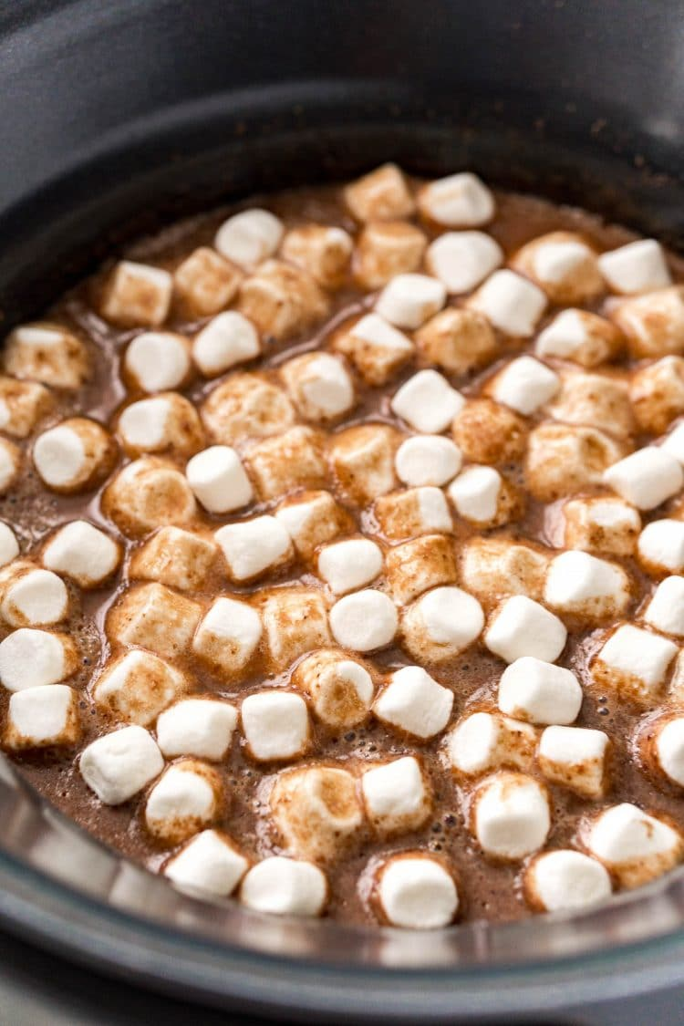 Mini marshmallows and hot chocolate in a crockpot.