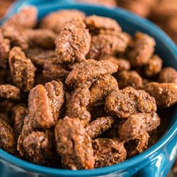 Gingerbread Candied Pecans in a blue serving bowl.