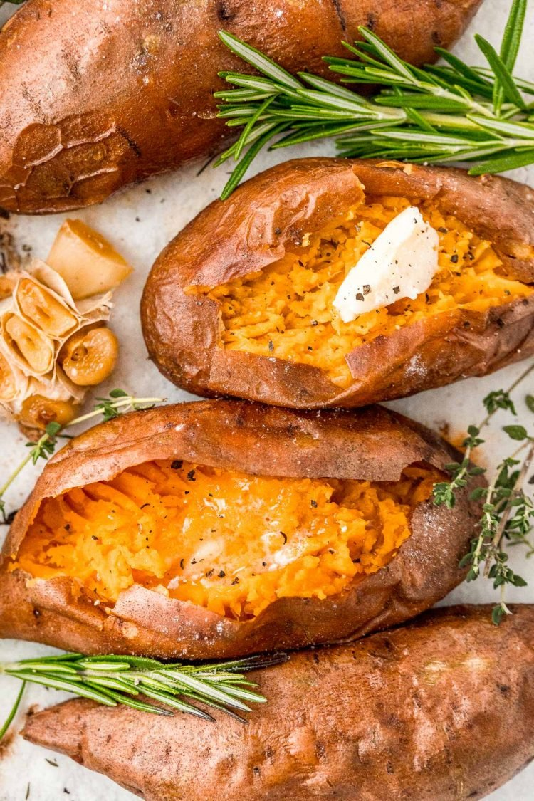 Overhead photos of baked sweet potatoes, the middle ones have been sliced into and topped with butter, salt, and pepper.