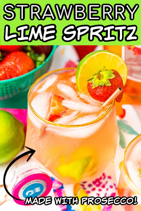 Close up photo of a glass with a pink gin cocktail garnished with lime and strawberry with text over it for pinning.