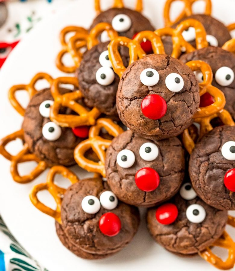 Reindeer Cookies stacked on top of each other on a white plate.
