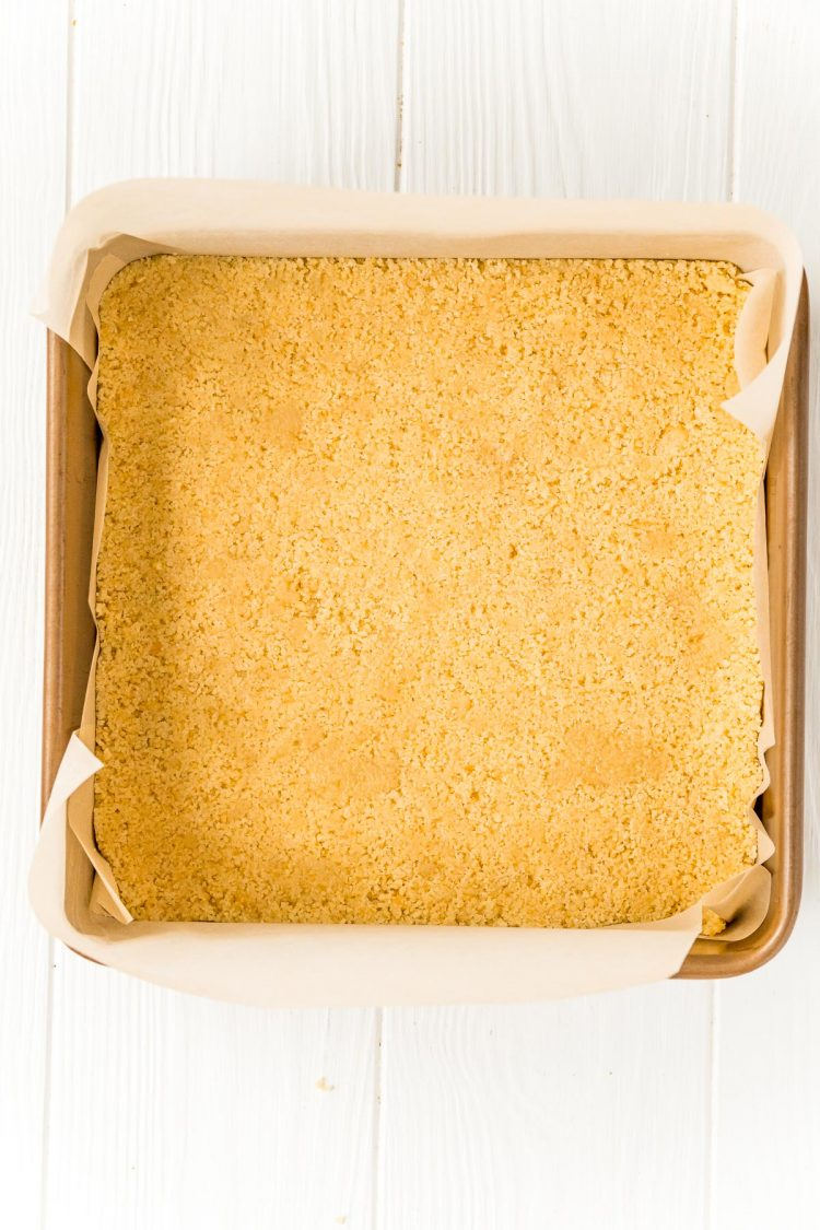 cookie crumbs in a square baking pan to make a crust.