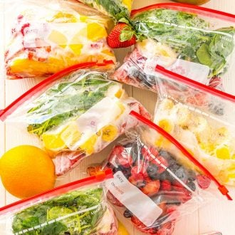 Frozen smoothie packs with fruit scattered around.