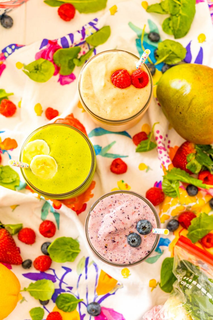 Overhead photo of smoothies surrounded by fruit