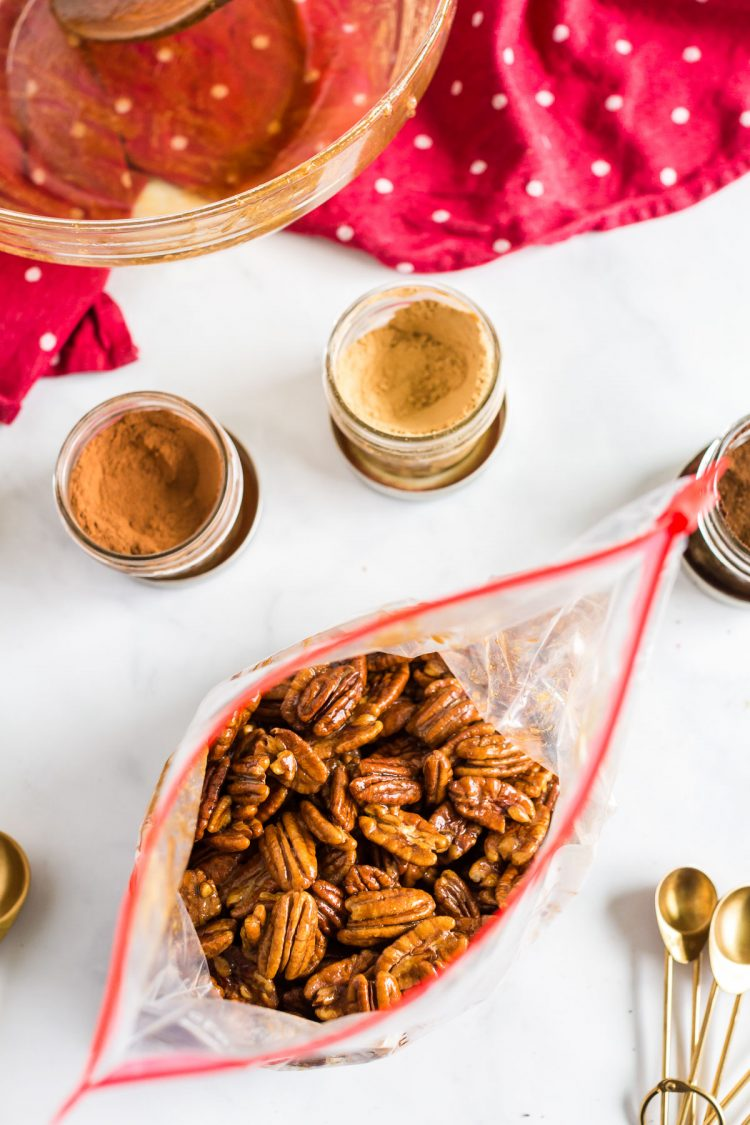 Pecans in a ziploc bag with sugar and spices.