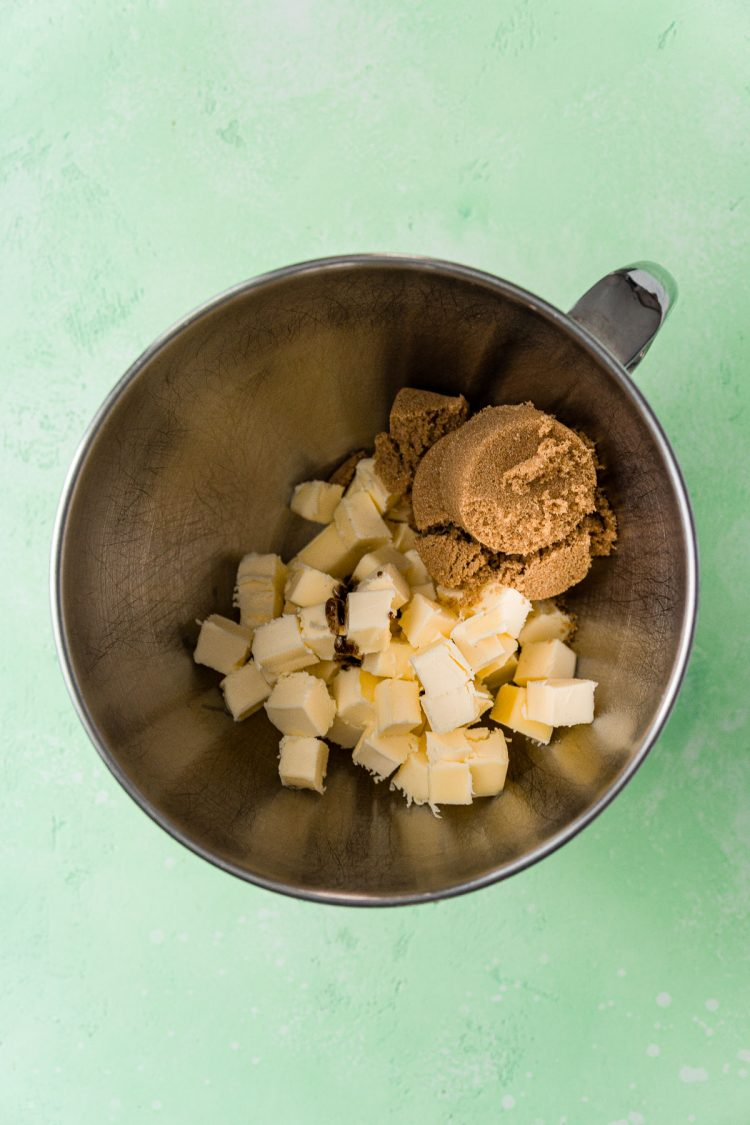 Butter and brown sugar in a metal mixing bowl.
