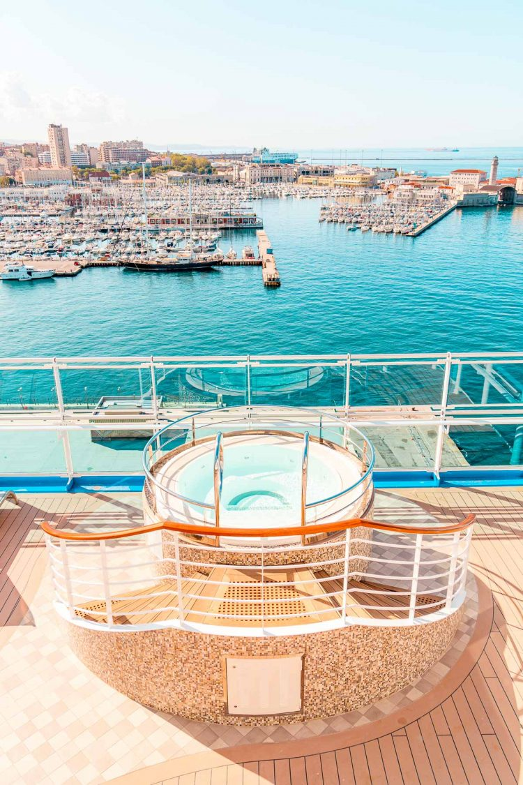 Hot tub on the edge of the Sky Princess cruise ship overlooking Trieste, Italy.