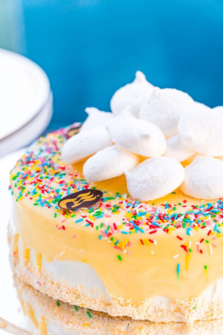 Cake covered in sprinkles and meringue cookies.