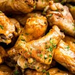 Chicken wings piled on top of each other in a bowl ready to eat.