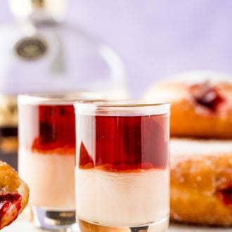 Close up photo of jelly donut shots.
