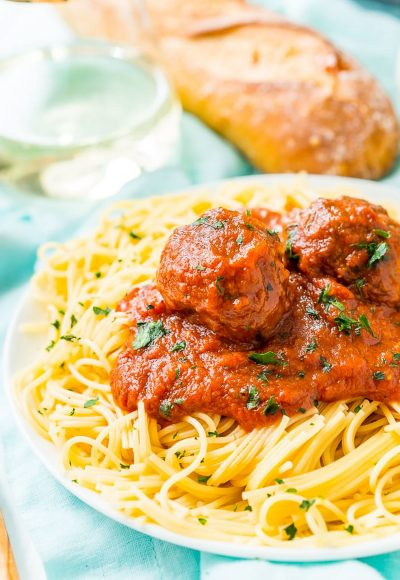 Meatballs on a plate of spaghetti.