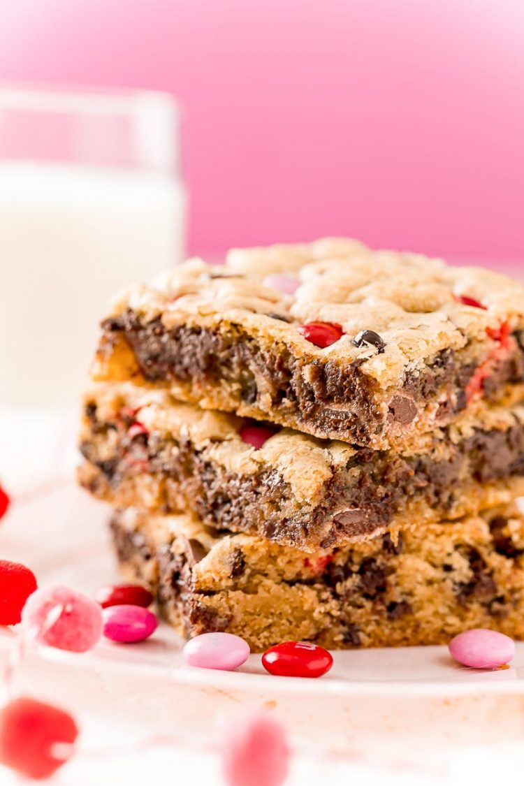 Close up photo of three chocolate chip cookie bars stacked on top of each other.