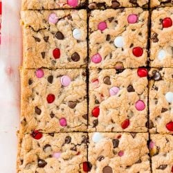 Overhead photo of a batch of slice chocolate chip cookie bars on parchment paper.