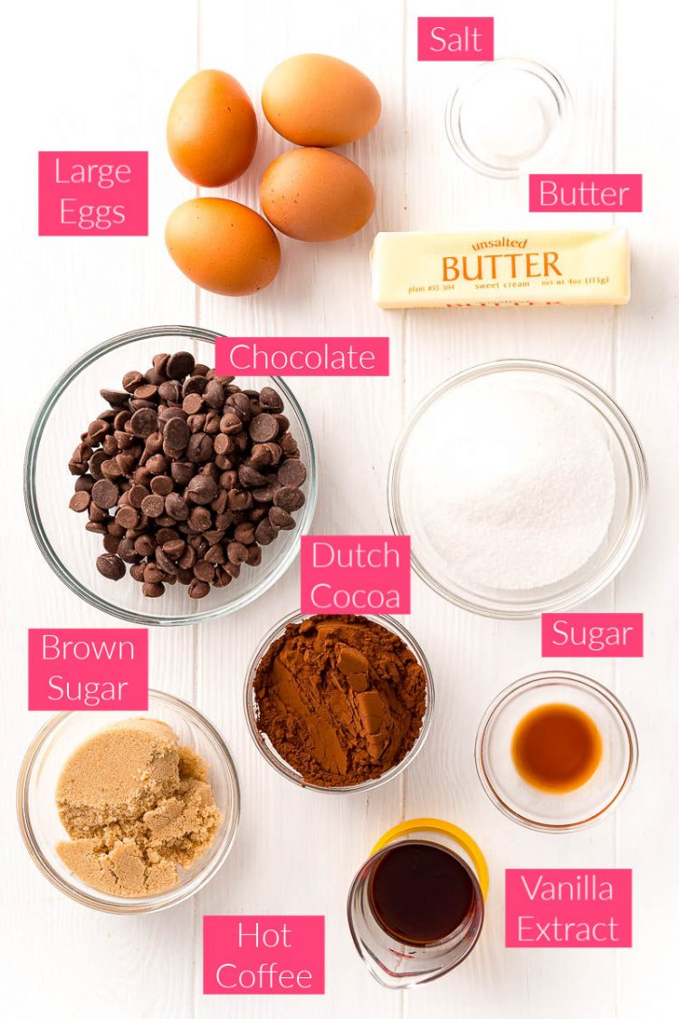 Overhead photo of the ingredients for flourless chocolate cake on a white table.