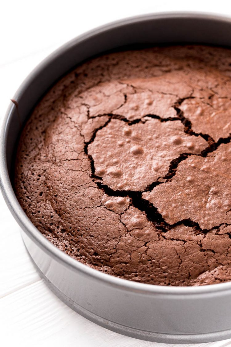 Close up photo of a flourless chocolate cake in the pan.