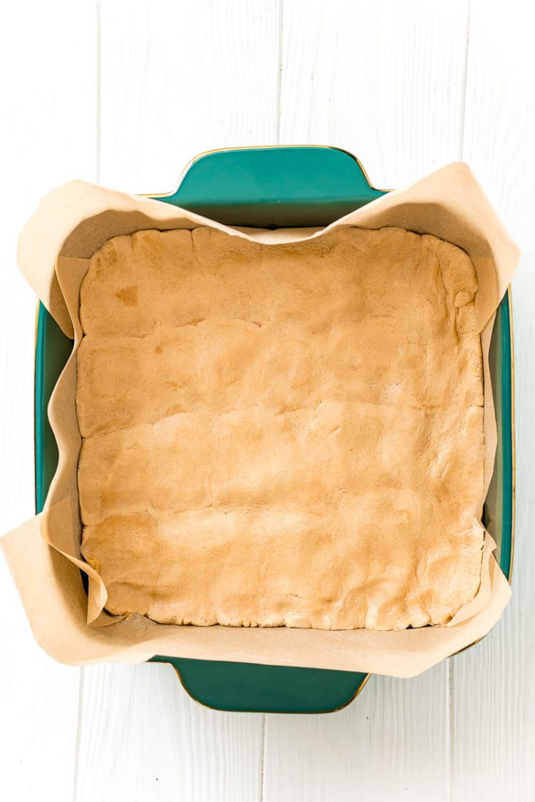 Overhead photo of a square baking dish filled with peanut butter cookie dough.